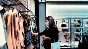 Person shopping for clothes with a face mask